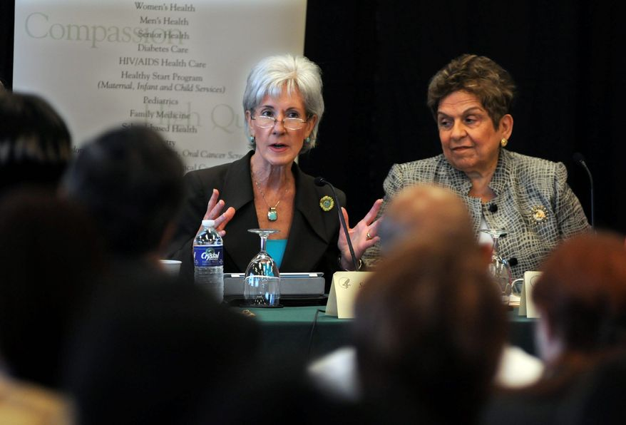 Secretary of Health and Human Services Kathleen Sebelius (left) and University of Miami President Donna Shalala, who had Mrs. Sibelius' job in the Clinton administration, discuss the still-divisive Affordable Care Act at a community health center in Miami. (Associated Press)