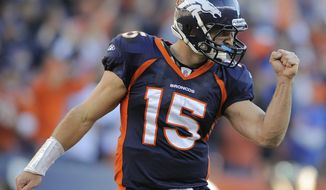 ** FILE ** Denver Broncos quarterback Tim Tebow reacts after a touchdown run by Broncos running back Lance Ball against the New England Patriots in an NFL football game in Denver on Sunday, Dec. 18, 2011.  (AP Photo/Jack Dempsey, File)