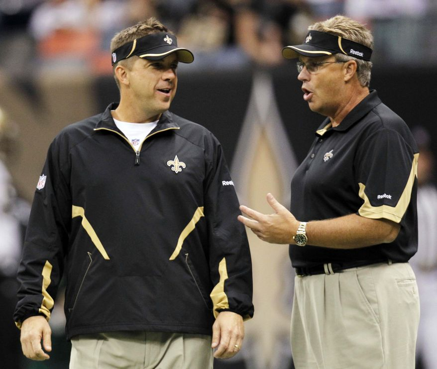 ** FILE ** In this Sept. 26, 2010, file photo, New Orleans Saints head coach Sean Payton and defensive coordinator Gregg Williams during their NFL football game at the Louisiana Superdome in New Orleans, La. (AP Photo/Gerald Herbert, File)