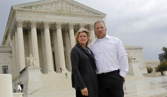 ** FILE ** In this Oct. 14, 2011, file photo, Mike and Chantell Sackett of Priest Lake, Idaho, pose for a photo in front of the Supreme Court in Washington. The Supreme Court ruled unanimously Wednesday that property owners have a right to prompt review by a judge of an important tool used by the Environmental Protection Agency to address water pollution. (AP Photo/Haraz N. Ghanbari, File)