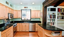 The kitchen, which was remodeled in 2006, has stainless steel appliances, black granite counters and maple cabinets. The kitchen opens onto the family room.