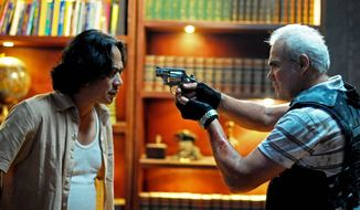 "Ray Sahetapy as crime boss Tama (left) is confronted by Pierre Gruno as Wahyu in a scene from ""The Raid: Redemption."" (Sony Pictures Classics)"