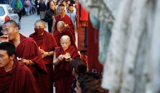 Tibetan monks living in exile participate in a candlelight vigil to show solidarity to those who have immolated themselves in Tibet, in Dharmsala, India, on Thursday.