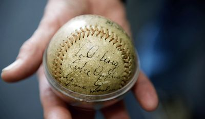 Jim Svehla holds a 1936 All-Star Game ball signed by Lou Gehrig that he found among his late father's belongings. He wants to get it authenticated and then sold. (Mary F. Calvert/Special to The Washington Times)