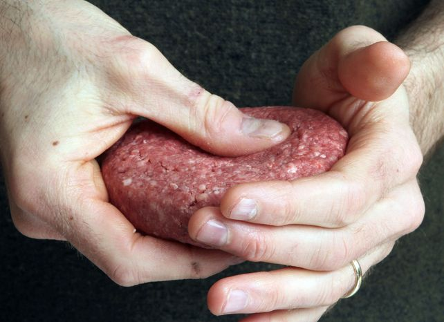 "A hamburger is made from ground beef containing a filler the meat industry calls ""lean, finely textured beef"" but critics label ""pink slime."" A growing number of grocery chains, including Kroger, Giant and Safeway, are offering meat without the additive. (Associated Press)"