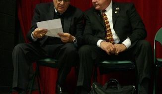 Maricopa County Sheriff Joe Arpaio (left) and Russell Pearce attend an Arizona Red Mountain Tea Party meeting in Mesa, Ariz., on Monday. The sheriff is in a tough fight to stay in office and Mr. Pearce is trying to regain a seat in his state's Senate. (East Valley Tribune via Associated Press)