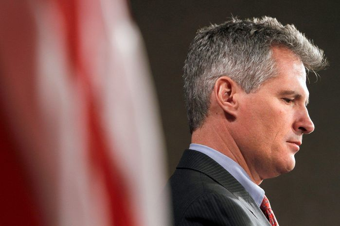 Sen. Scott P. Brown cites his mother's history of abusive relationships with men as he pushes for renewal of a domestic-violence law. (Associated Press)