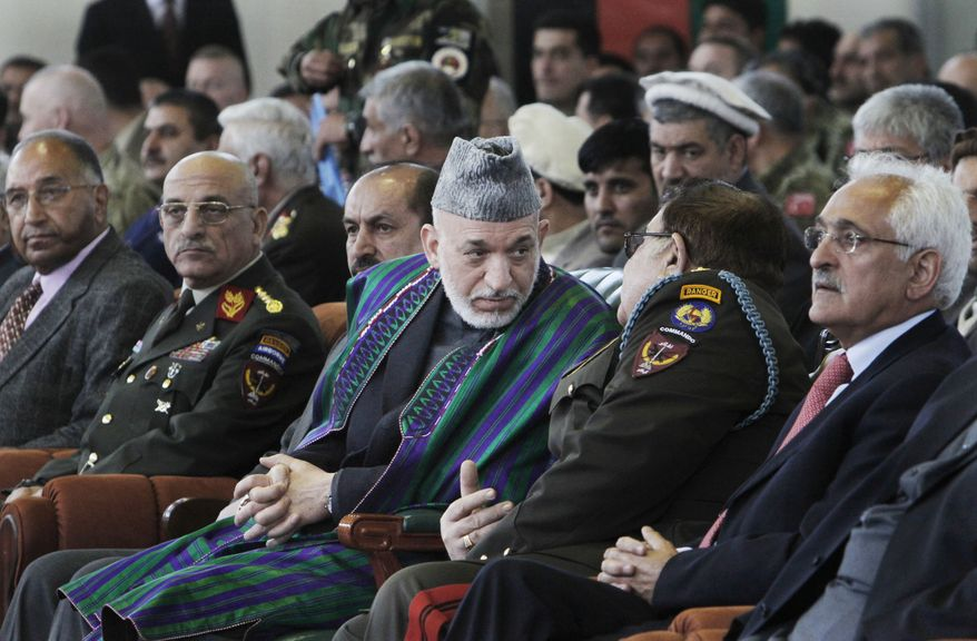 Afghan President Hamid Karzai (center) attends graduation exercises for Afghan military officers in Kabul, Afghanistan, on Thursday, March 22, 2012. (AP Photo/Musadeq Sadeq)