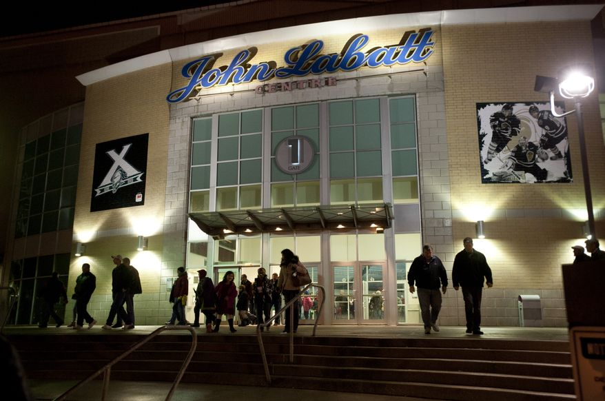 Hockey fans leave the John Labatt Centre after watching their hometown junior hockey team, the London Knights, defeat the visiting Oshawa Generals in London, Ontario, Canada on Friday March 2, 2012.  The Knights beat the Generals with a final score of 7-2. (Craig Glover/Special to The Washington Times)