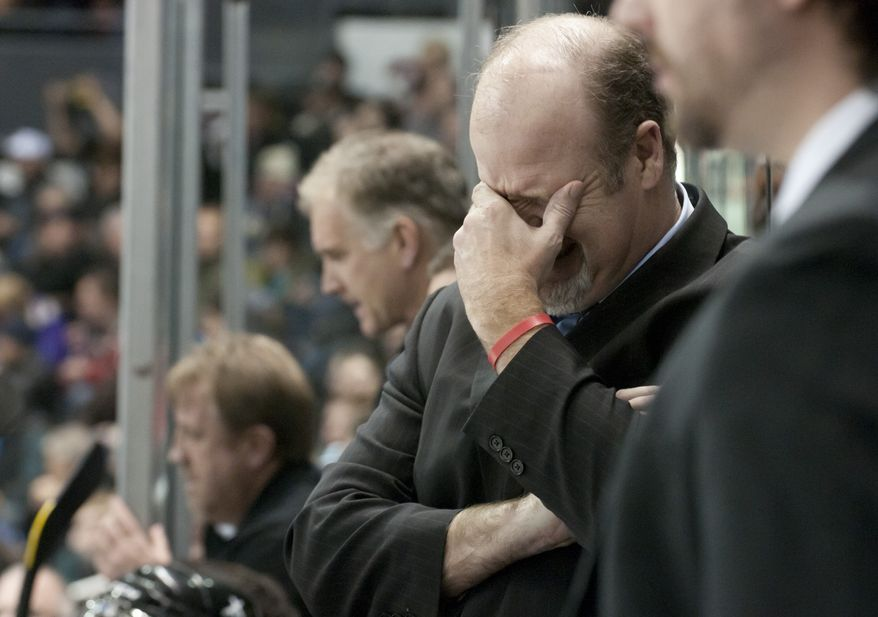London Knights head coach Mark Hunter reacts to a play while standing on the bench during their junior hockey game against the Oshawa Generals at the John Labatt Centre in London, Ontario, Canada on Friday March 2, 2012.  Mark took over the role after his brother, Dale Hunter, became head coach of the Washington Capitals. (Craig Glover/Special to The Washington Times)