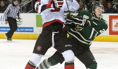 Ottawa 67's forward Steven Janes, left, collides with London Knights defenseman Olli Maatta, right, as they skate into the neutral zone during their junior hockey game at the John Labatt Centre in London, Ontario, Canada on Saturday March 3, 2012. (Craig Glover/Special to The Washington Times)