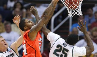 Louisville's Chane Behanan dunks against Michigan State's Derrick Nix (25) as Michigan State's Austin Thornton (13) looks on during the second half of a Sweet 16 NCAA tournament game on Thursday, March 22, 2012, in Phoenix. (AP Photo/Matt York)