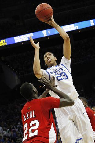 Kentucky forward Anthony Davis (23) shoots over Western Kentucky's Teeng Akol (22) in the first half of their NCAA tournament second-round college basketball game in Louisville, Ky., Thursday, March 15, 2012. (AP Photo/Dave Martin)