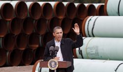 President Obama speaks on energy matters at the TransCanada pipe yard in Cushing, Okla., on Thursday, March 22, 2012. (AP Photo/L.M. Otero)