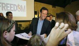 Republican presidential candidate and former Pennsylvania Sen. Rick Santorum greets supporters March 21, 2012, after a rally in Mandeville, La. (Associated Press)
