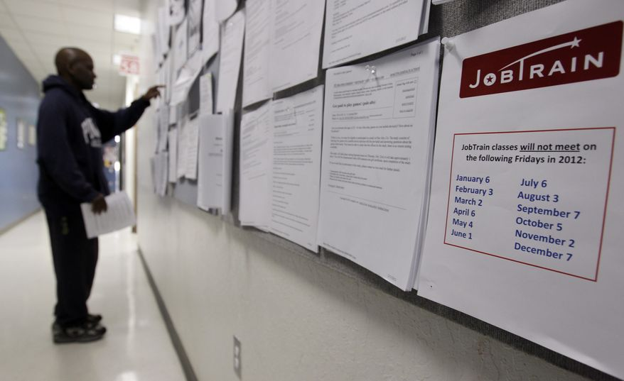 A job seeker checks the bulletin board at a Job Train employment center in Menlo Park, Calif., on Tuesday, Feb. 14, 2012. (AP Photo/Paul Sakuma)