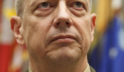 Marine Gen. John Allen, the top U.S. commander in Afghanistan, tells the House Armed Services Committee on Capitol Hill on March 20, 2012, that efforts to hand over security to the Afghans and wind down the decade-plus war are on track despite recent anger over a U.S. soldier's alleged massacre of Afghan civilians and the burning of Korans. (Associated Press)