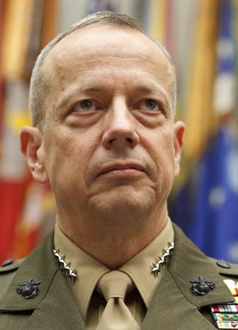 Marine Gen. John Allen, the top U.S. commander in Afghanistan, tells the House Armed Services Committee on Capitol Hill on March 20, 2012, that efforts to hand over security to the Afghans and wind down the decade-plus war are on track despite recent anger over a U.S. soldier's alleged massacre of Afghan