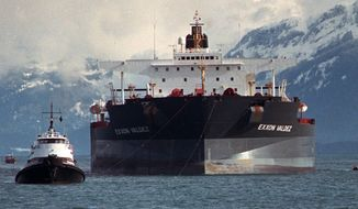**FILE** Tugboats pull the crippled tanker Exxon Valdez towards Naked Island in Prince William Sound, Alaska, on April 5, 1989, after the ship was pulled from Bligh Reef. (Associated Press)