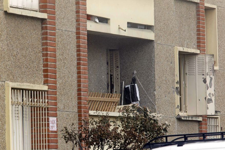 The exterior of Mohamed Merah's apartment building in Toulouse, France, is seen on March 23, 2012. Mohamed Merah, who boasted of killing seven people to strike back at France, died the previous day after being shot in the head by police as he jumped out of his apartment after a fierce gunfight with police, authorities said. (Associated Press)