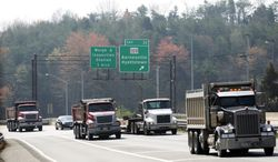 Northbound vehicles drive on Interstate 270 past the exit to Hyattstown, Md., on March 23, 2012. (Associated Press)