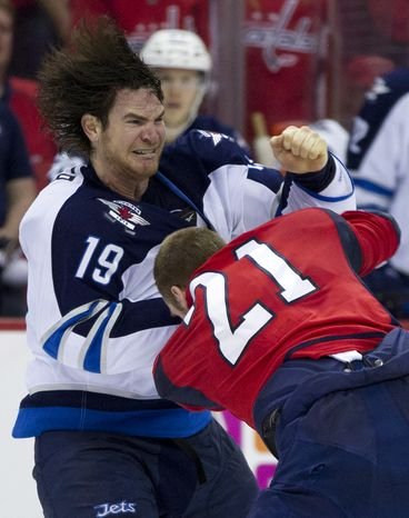Winnipeg Jets center Jim Slater fights with Washington Capitals center Brooks Laich during the second period Friday, March 23, 2012, in Washington. (AP Photo/Evan Vucci)