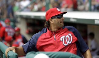 Washington Nationals outfielder Michael Morse has been sidelined since March 6 with a strained lat, but he should return to resume baseball activities on Sunday. (AP Photo/Julio Cortez)