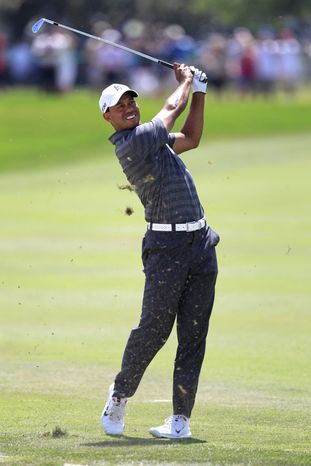 Tiger Woods hits a shot to the green from the first fairway during the third round of the Arnold Palmer Invitational tournament at Bay Hill, Saturday, March 24, 2012, in Orlando, Fla. (AP Photo/John Raoux)