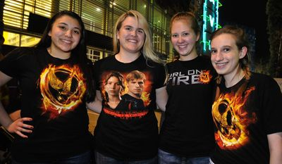 "Hunger Game fans KayLeigh Nava, Jacey Patton, Sarah Martin and Ashley Folkertsma line up to see the midnight shows of ""The Hunger Games,"" at Rave Motion Pictures Northeast in Hurst, Texas, on Thursday, March 22, 2012. (AP Photo/The Fort Worth Star-Telegram, Max Faulkner)"