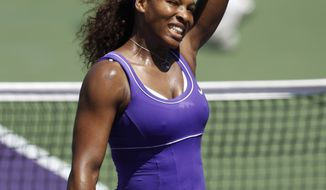 Serena Williams waves after defeating Roberta Vinci of Italy, 6-2, 6-1, at the Sony Ericsson Open tennis tournament, Saturday, March 24, 2012, in Key Biscayne, Fla. (AP Photo/Lynne Sladky)