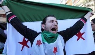 An anti-Syrian regime protester holds a Syrian revolution flag and chants slogans against Syrian President Bashar Assad during a demonstration after Friday prayers in Beirut, Lebanon, Friday, March 23, 2012. (AP Photo/Bilal Hussein)