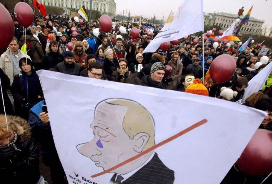 Demonstrators carry a poster Saturday showing a caricature of Russian Prime Minister and now President-elect Vladimir Putin during a protest in St. Petersburg against Kremlin policies and suspected vote rigging. Mr. Putin made his most lavish election promises about three weeks ahead of the March 4 election. (Associated Press)