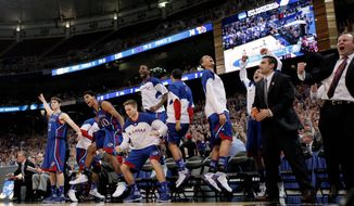 Kansas players exult during the second half of their regional final against North Carolina. The Jayhawks finished their  80-67 win with a 12-0 run. (Associated Press)
