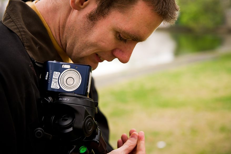 "Autistic adult Matt D. with Community Services for Autistic Adults and Children, based in Montgomery Village, Md., gets ready to depart after taking photographs of the Cherry Blossoms along the Tidal Basin, Washington, D.C., Wednesday, March 21, 2012. The ""InFocus Project†is a way for adults with autism to develop forms of self expression and social skills while producing work that has been featured in art shows, given to donors to C.S.A.A.C., and sold on an online store. (Andrew Harnik/The Washington Times)"