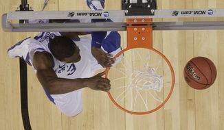 Kentucky's Terrence Jones (3) dunks the ball against Baylor during the second half of an NCAA tournament South Regional finals college basketball game Sunday, March 25, 2012, in Atlanta. (AP Photo/John Bazemore)