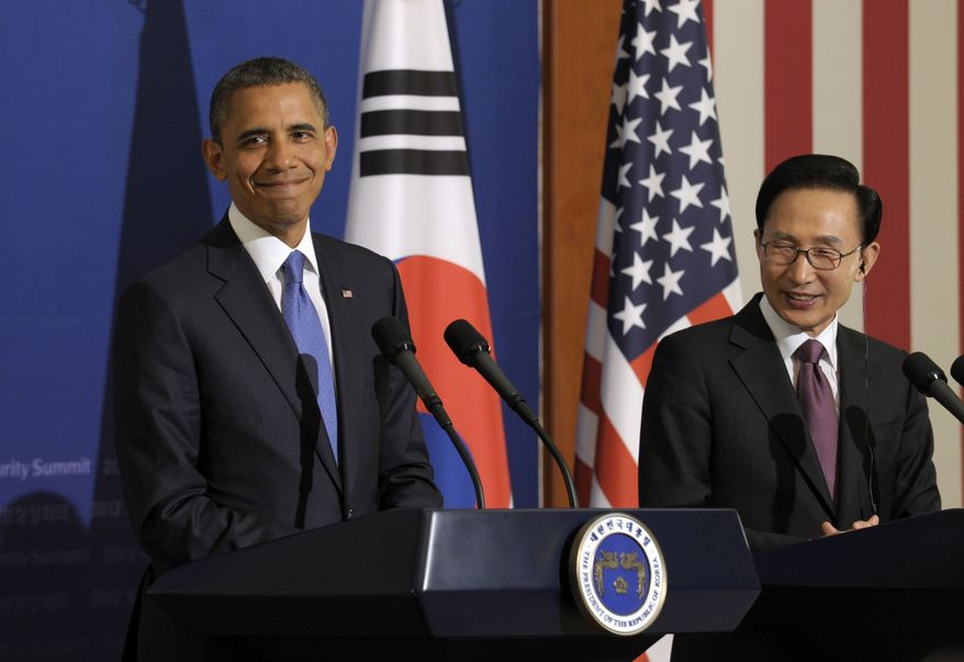 President Obama and South Korean President Lee Myung-bak smile during a news conference at the Blue House, the official presidential house, in Seoul on Sunday, March 25, 2012. (AP Photo/Susan Walsh)