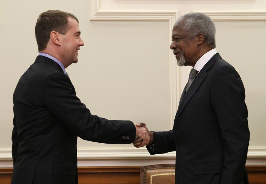 Russian President Dmitry Medvedev (left) greets former U.N. Secretary-General Kofi Annan, the U.N.-Arab League envoy to Syria, in Moscow on Sunday, March 25, 2012. (AP Photo/AP Photo, RIA Novosti Kremlin, Ekaterina Shtukina, Presidential Press Service)