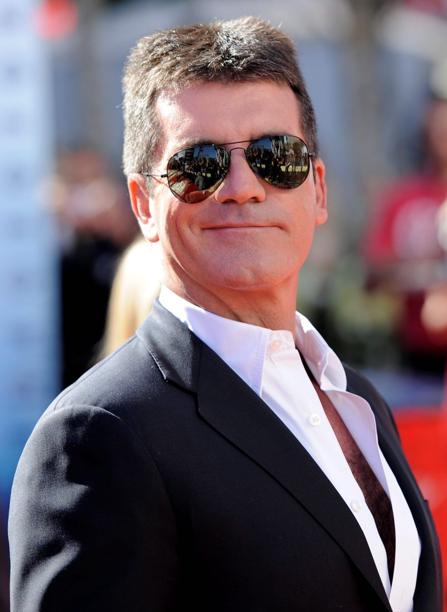 """The X Factor"" producer Simon Cowell was ""shaken up"" after a woman allegedly broke into his home wielding a broken brick. The suspect, Leanne Zaloumis, 29, was charged with aggravated burglary after the incident Saturday night. (Associated Press)"