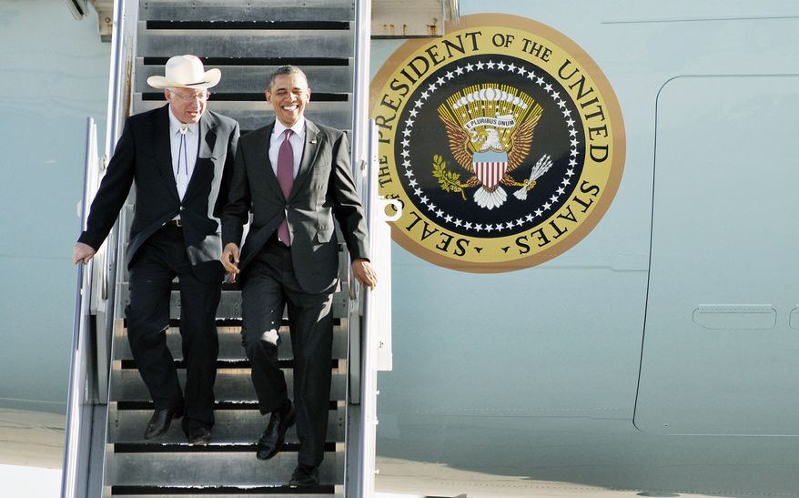 President Obama and Secretary of the Interior Kenneth L. Salazar exit Air Force One at the Roswell International Air Center in Roswell, N.M., last week. Over the weekend, Mr. Obama issued a release inviting industry input on an oil and gas lease sale in Alaska's Cook Inlet. (Associated Press)