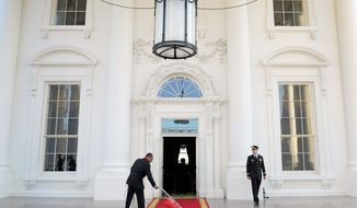 The red carpet of the North Portico is prepared for President Obama to welcome British Prime Minister David Cameron to the White House for a state dinner earlier this month. Mr. Obama is using privileged access to one of America's greatest landmarks to reward his most generous financial supporters. (Associated Press)