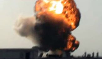 This image made from amateur video and released by Shaam News Network on Saturday, March 24, 2012, purports to show a fireball after rockets fell in the Khaldiyeh area of Homs, Syria. (AP Photo/Shaam News Network via AP video)