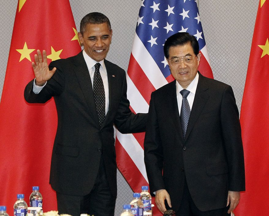 President Obama greets Chinese President Hu Jintao at the start of their bilateral meeting in Seoul on Monday, March 26, 2012. (AP Photo/Pablo Martinez Monsivais)