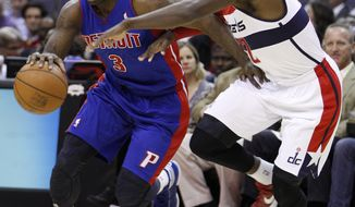 Detroit Pistons guard Rodney Stuckey (3) drives to the basket against Washington Wizards guard Shelvin Mack during the first half of the Pistons' 79-77 victory on March 26, 2012 in Washington. (Associated Press)