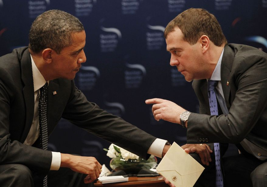 ** FILE ** Unaware that a microphone was recording him, President Obama asked outgoing Russian President Dmitry Medvedev on Monday, March 26, 2012, for breathing room until after Mr. Obama's re-election campaign to negotiate on missile defense. (AP Photo/Pablo Martinez Monsivais)