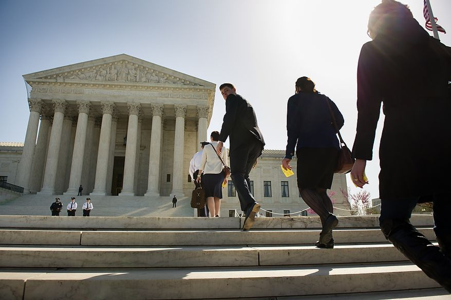 People waiting in long lines outside the U.S. Supreme Court building are led inside March 26, 2012, for the chance to watch for three minutes as the court hears oral arguments on the challenges to the Affordable Care Act. (Andrew Harnik/The Washington Times)
