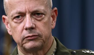 Marine Gen. John Allen, the top U.S. commander in Afghanistan, listens March 26, 2012, during a news conference at the Pentagon. (Associated Press)