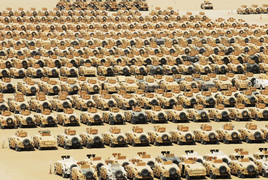 A collection of vehicles built to resist mine blasts and protect occupants from ambush are parked in a holding yard at Camp Arifjan, Kuwait, awaiting shipment. (Army photograph)