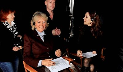 """Britain's Duchess of Cornwall (second from left) and Danish Crown Princess Mary (right) on Tuesday visit the set of the Danish TV drama """"The Killing"""" in Lynge. (Polfoto via Associated Press)"""