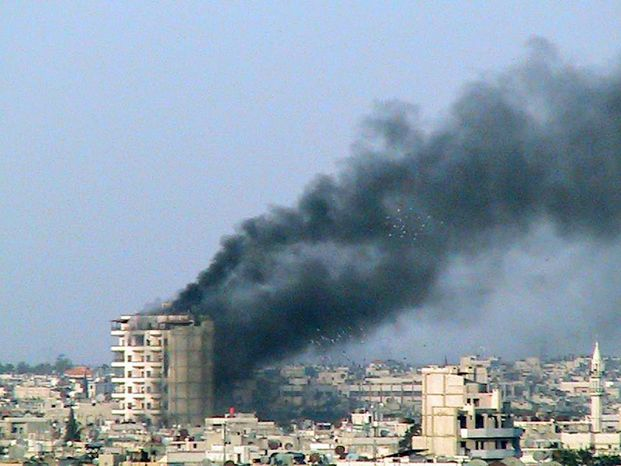 This early March citizen journalism image provided to AP by the Homs City Union of the Syrian Revolution shows a building in the city reportedly shelled by the Syrian army.