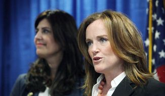 Nassau County District Attorney Kathleen Rice (right) joins Kathryn Juric, vice president of the SAT program for the College Board, in Mineola, N.Y., on Tuesday as they announce a security overhaul to prevent cheating on the SAT exams.